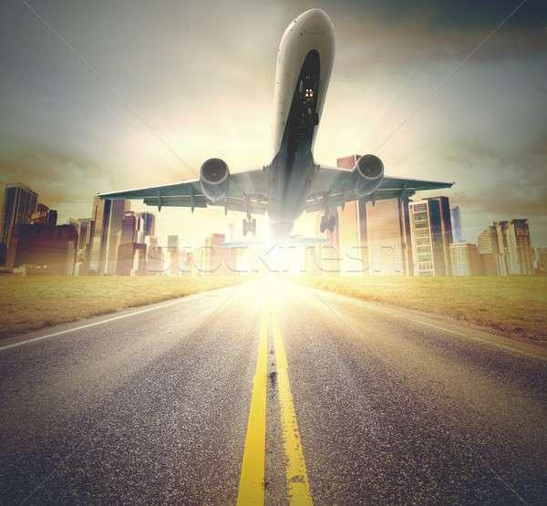 Repülőgép felszállás repülőgép el égbolt épület Stock fotó © alphaspirit