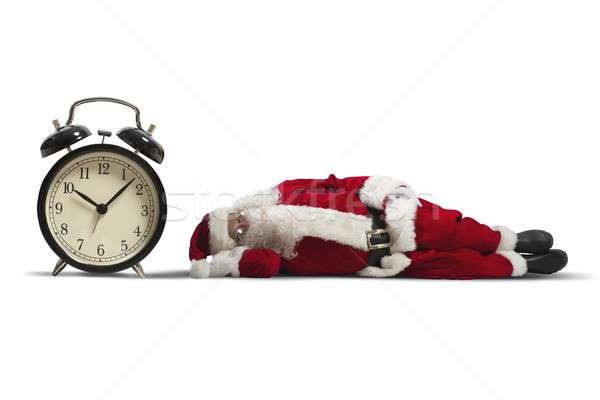 Święty mikołaj zmęczony zegar zimą czasu Zdjęcia stock © alphaspirit