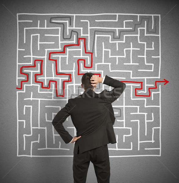 Confused business man seeks a solution to the labyrinth Stock photo © alphaspirit