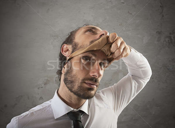Businessman that removes the mask. Concept of falsity Stock photo © alphaspirit