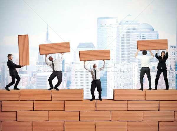 Teamwork builds a new business Stock photo © alphaspirit