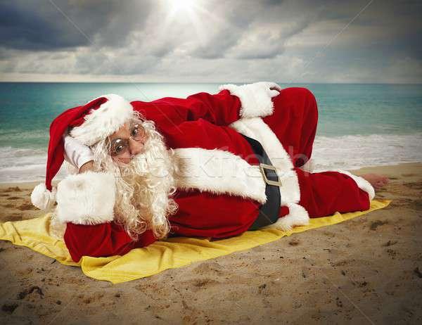 Strandvakantie kerstman ontspannen strandlaken oceaan winter Stockfoto © alphaspirit