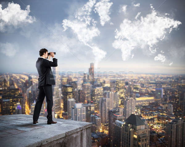 Empresário olhando futuro cidade telhado Foto stock © alphaspirit