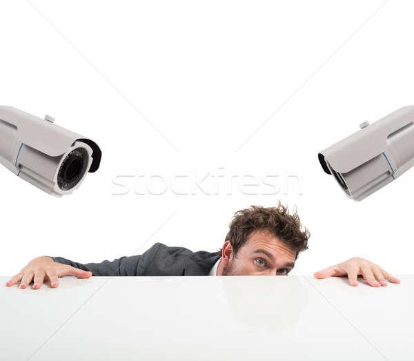 Rejtőzködik ellenőrzés áramkör fényképezőgépek üzletember férfi Stock fotó © alphaspirit