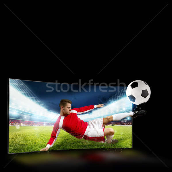 Diffuser tv footballeur sur coup Photo stock © alphaspirit
