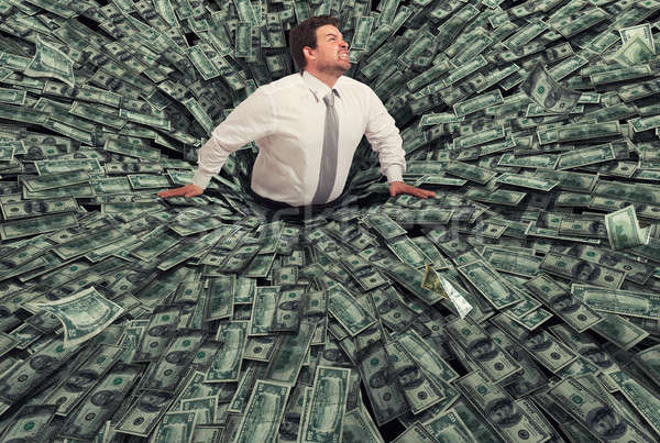 Businessman swallowed by a black hole of money. Concept of failure and economic crisis Stock photo © alphaspirit