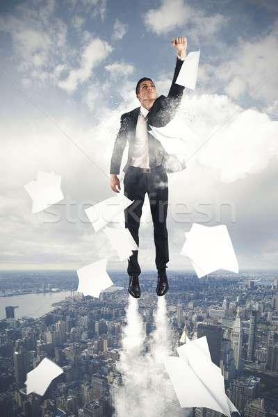Stock photo: Flying Super hero businessman