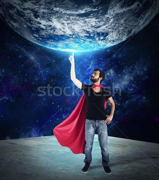 Superhero świat palec świecie człowiek pomoc Zdjęcia stock © alphaspirit