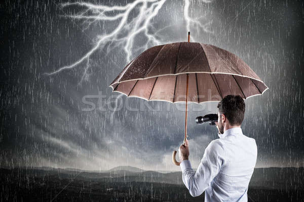 Business storm crisis zakenman paraplu man Stockfoto © alphaspirit