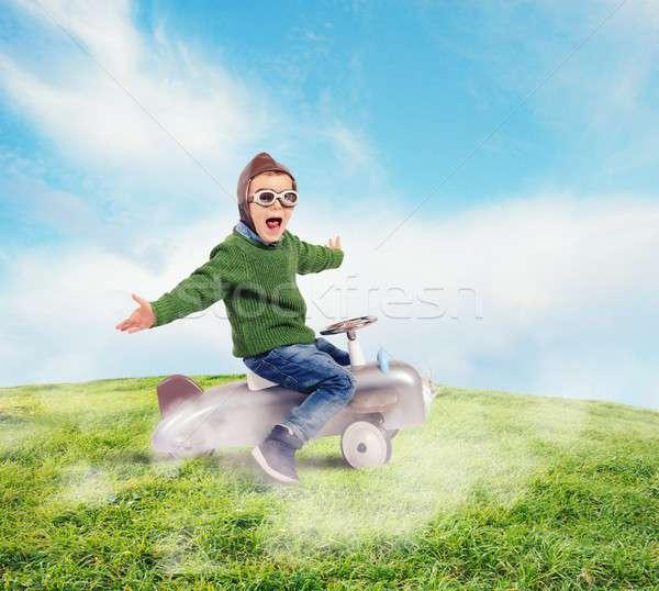 Cheerful boy kid playing at the aviator Stock photo © alphaspirit