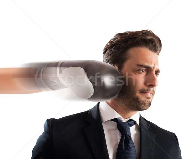 Punched businessman Stock photo © alphaspirit
