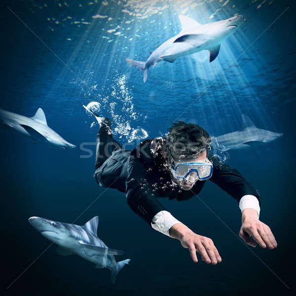 Natação corajoso empresário homem peixe Foto stock © alphaspirit