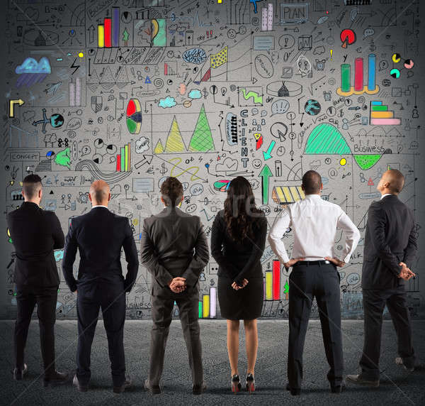 Business team drawing a new complex project Stock photo © alphaspirit