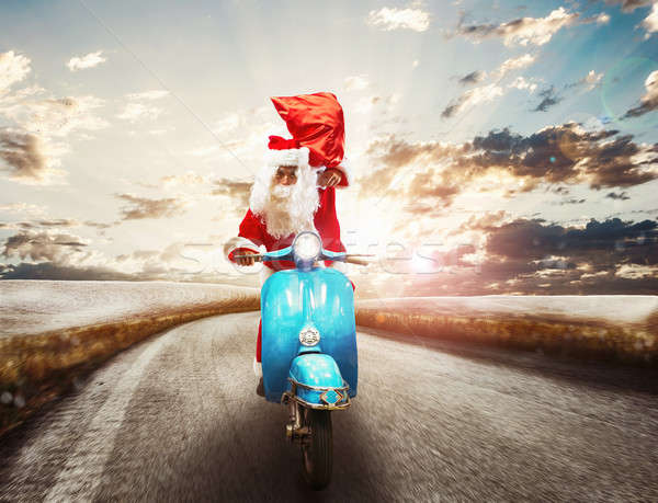 Fast Santa Claus on motorbike Stock photo © alphaspirit