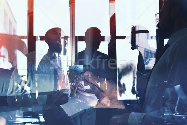Businessmen that work together in office. Concept of teamwork and partnership. double exposure Stock photo © alphaspirit