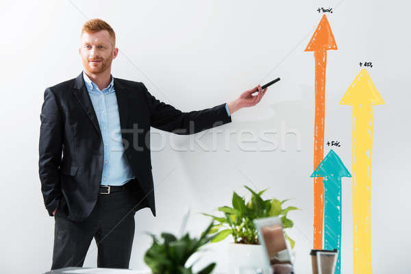 Businessman draws positive statistics of his company. Concept of success Stock photo © alphaspirit