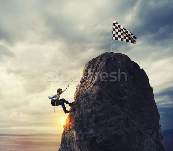 Businessman try to reach the goal. Difficult career concept Stock photo © alphaspirit