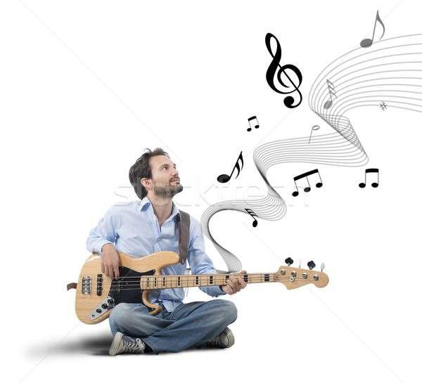 Boy with bass guitar Stock photo © alphaspirit