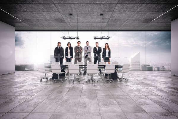 Csapatmunka megbeszélés sikeres üzlet tárgyalóterem iroda Stock fotó © alphaspirit