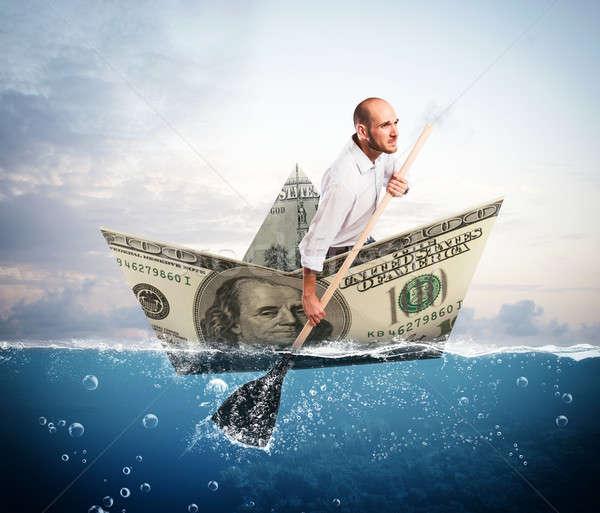Ontsnappen bankbiljet boot zakenman groot schip Stockfoto © alphaspirit