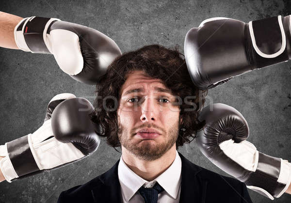 Punched guilty businessman Stock photo © alphaspirit
