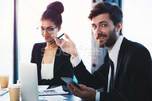 Business people work together. Teamwork and partnership concept Stock photo © alphaspirit