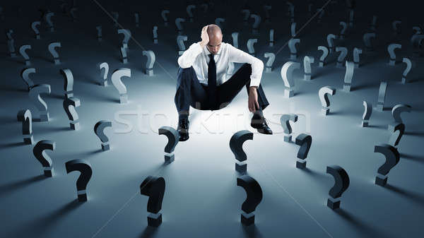 Businessman with many question marks. Concept of failure and problem Stock photo © alphaspirit