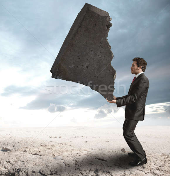 Businessman challenging the difficulties Stock photo © alphaspirit