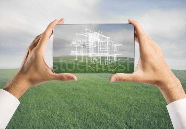 Architect showing new house project Stock photo © alphaspirit