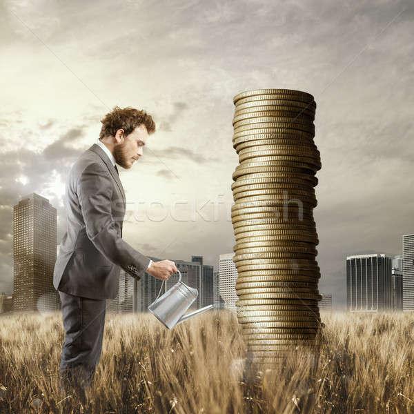 Creciente economía empresario dinero monedas Foto stock © alphaspirit