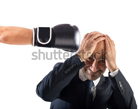 Businessman receives fists from competitors. concept of difficult career Stock photo © alphaspirit