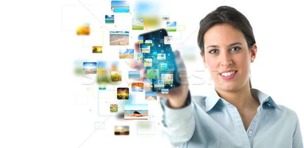 Streamelés mobiltelefon szalag üzlet lány telefon Stock fotó © alphaspirit