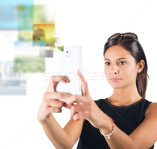 Meisje foto's mobiele telefoon telefoon internet telefoon Stockfoto © alphaspirit