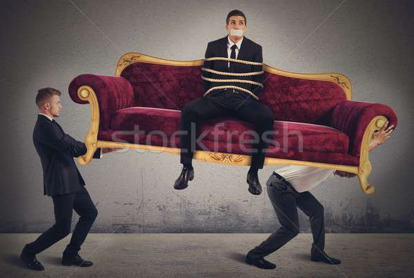 Trapped businessman transported Stock photo © alphaspirit