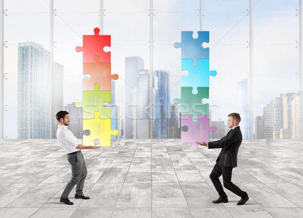 Cooperation at work Stock photo © alphaspirit