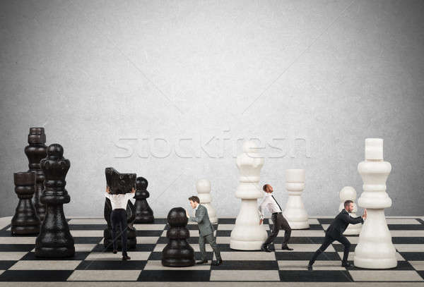 Strategie tactiek business zakenlieden verplaatsen schaakstukken Stockfoto © alphaspirit