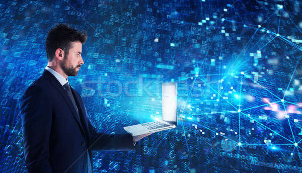 Programmer man works with a laptop on a network application Stock photo © alphaspirit