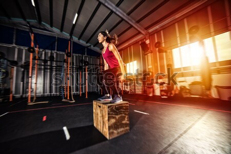 Athletic man does box jump exercises at the gym Stock photo © alphaspirit
