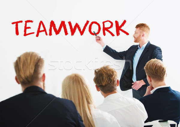 Businessman in office explain something about teamwork at a training meeting Stock photo © alphaspirit