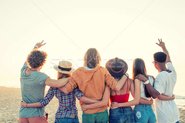 Stock photo: Group of happy friends having fun at ocean beach