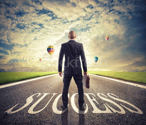 Man walks on a success way. Concept of successful businessman and company startup Stock photo © alphaspirit