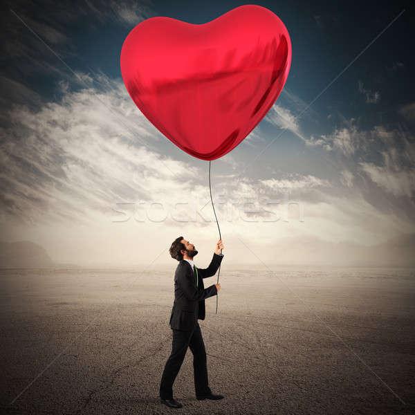 Regarder amour homme grand rouge coeur Photo stock © alphaspirit