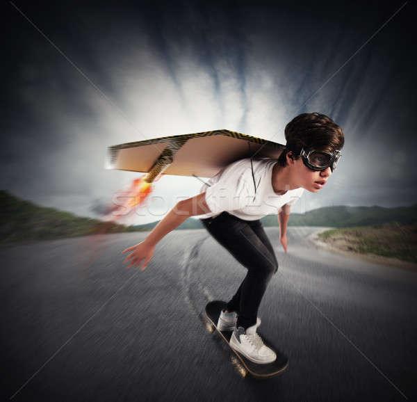 Hamar korcsolya fiú karton szárnyak tűz Stock fotó © alphaspirit
