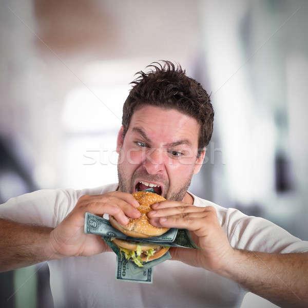 Hebzuchtig vet zakenman sandwich bankbiljetten diner Stockfoto © alphaspirit