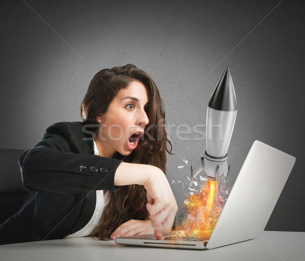 Businesswoman launches rocket from a laptop. concept of company startup Stock photo © alphaspirit