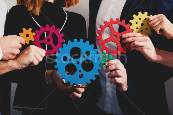 Business team connect pieces of gears. Teamwork, partnership and integration concept Stock photo © alphaspirit
