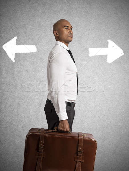Businessman must choose between different destinations. concept of difficult career Stock photo © alphaspirit