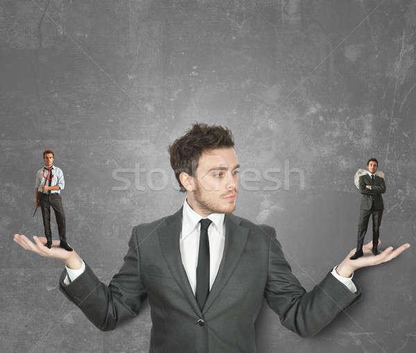 Businessman with devil or angel Stock photo © alphaspirit