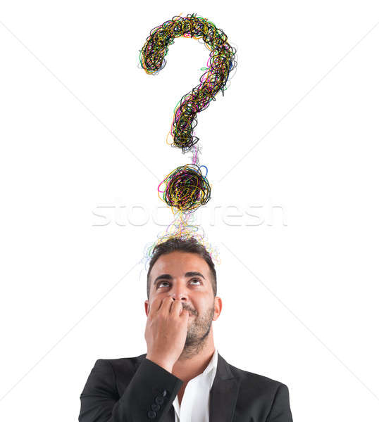 Businessman with big question Stock photo © alphaspirit