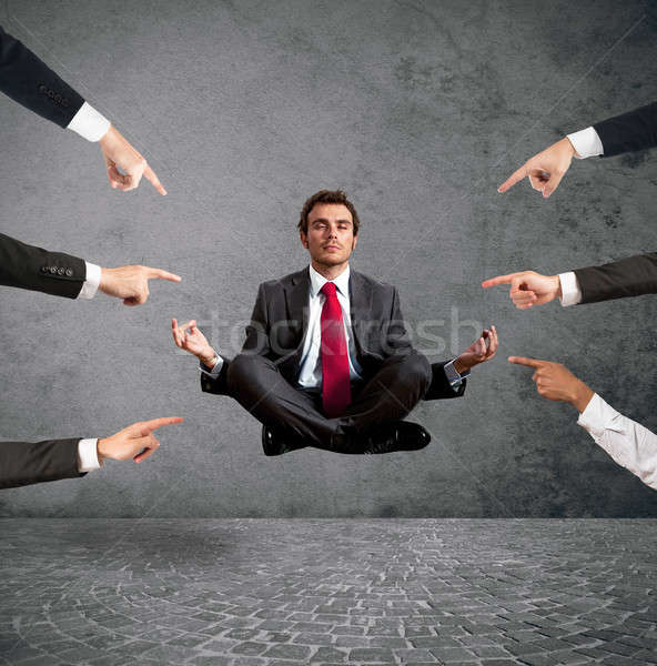 Relaxed businessman under the accusations of colleagues Stock photo © alphaspirit
